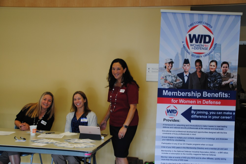 WID Florida First Coast Chapter President Amanda Hawkins and fellow WID members help register guests for the WID EMPOWER Event May 11, 2019